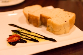 The presentation of the bread is nice, but I prefer to pour my own olive oil and vinegar.