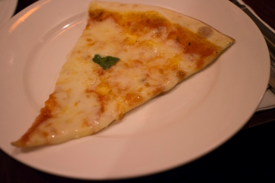 A slice of Margherita pizza.